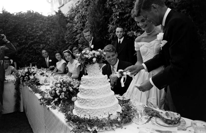 Not published in LIFE. Guests, including Robert Kennedy, watch as newly married John and Jackie Kennedy cut their wedding cake, Newport, R.I., Sept. 12, 1953.